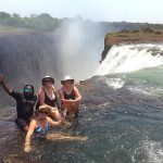 The MacLean sisters in Devil's Pool during the Livingstone Island tour of the Victoria Falls