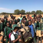 """Walter making some new friends during a """"Tour the Township"""" in Victoria Falls, taken by Grace Chen"""